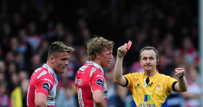 Tavis Knoyle of Gloucester (L) receives a red card from referee Tim Wigglesworth