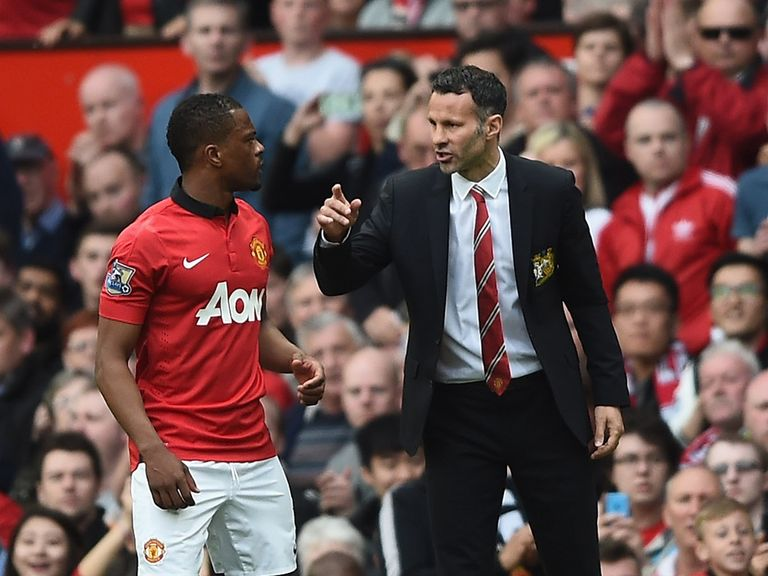 Ryan Giggs speaks with Patrice Evra during the 4-0 win at Old Trafford