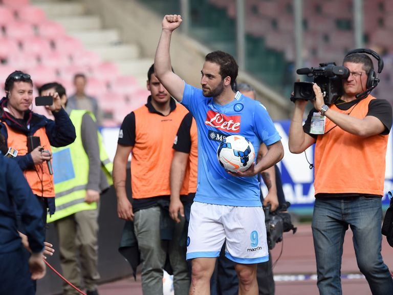 Gonzalo Higuain takes home the match ball after his hat-trick