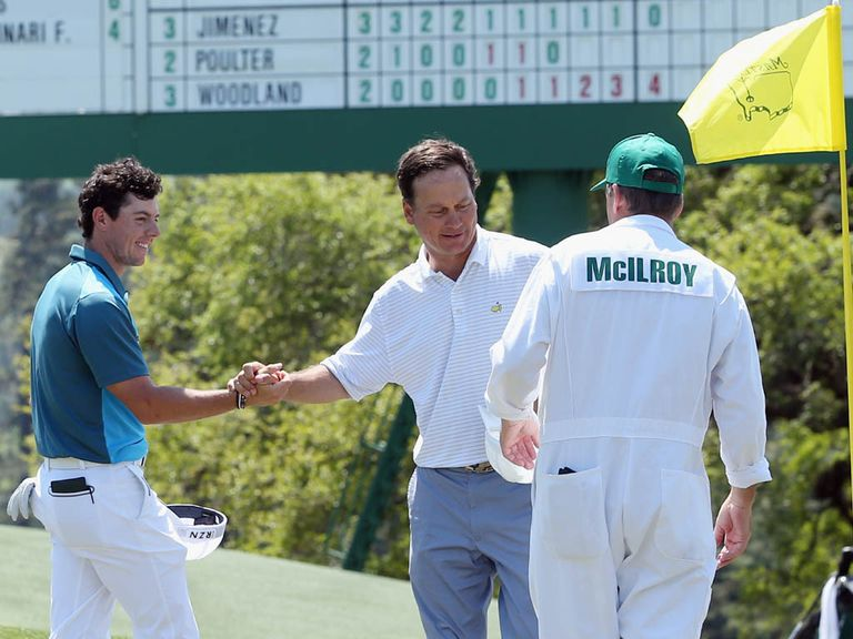 Rory McIlroy (l) shakes hands with marker Jeff Knox