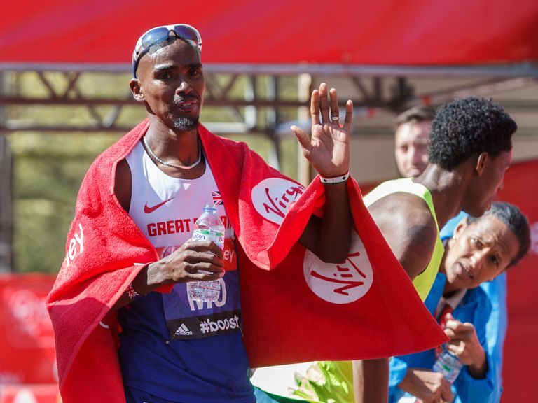 Mo Farah waves after finishing in eighth place
