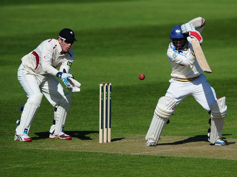 Adil Rashid of Yorkshire bats as Craig Kieswetter of Somerset looks on