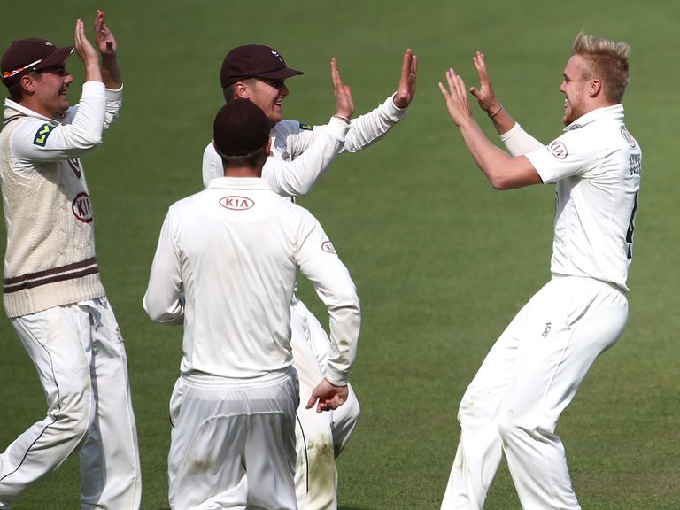 Surrey celebrate one of their wickets against Essex