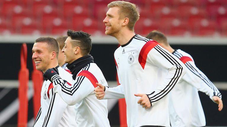 Lukas Podolski (l): Feels Mesut Ozil (c) can only get better
