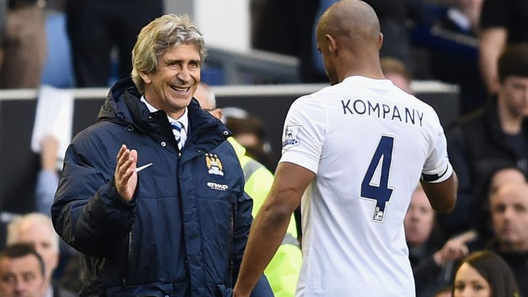 Manuel Pellegrini and Vincent Kompany embrace after the win at Everton