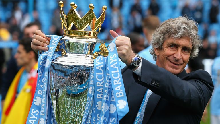Pellegrini lifting the Premier League trophy at the end of the 2013/14 season