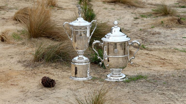 The Women's US Open trophy (right) is displayed next to the men's in a press day at Pinehurst.
