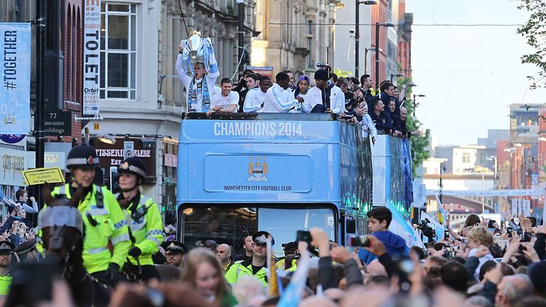 Manchester City players and fans celebrate title on Monday evening