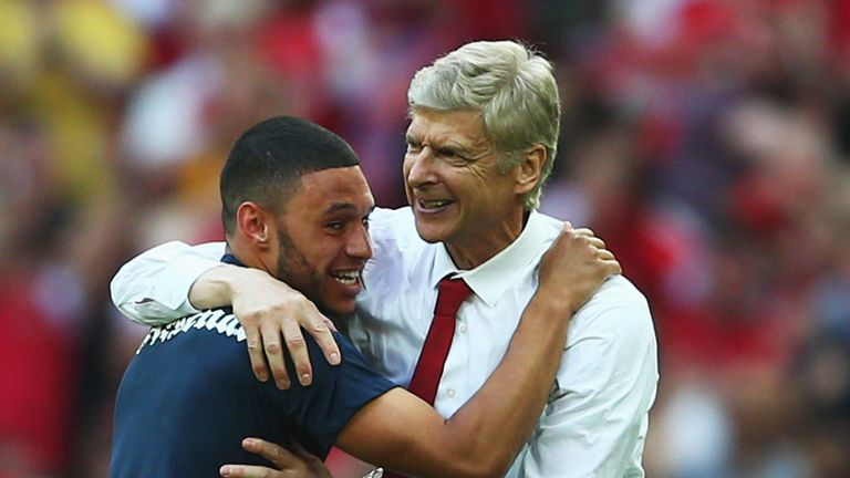 Arsene Wenger embraces Alex Oxlade-Chamberlain after ending Arsenal's long trophy drought