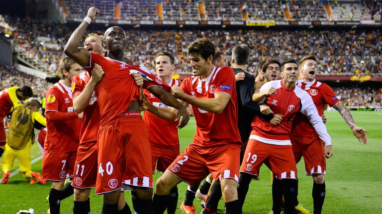 Stephane Mbia celebrates Sevilla's late goal