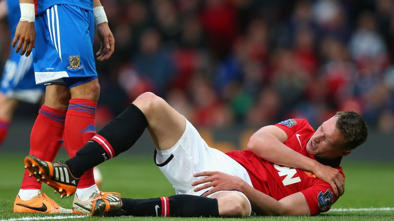Phil Jones holds his shoulder during Manchester United's clash with Hull City