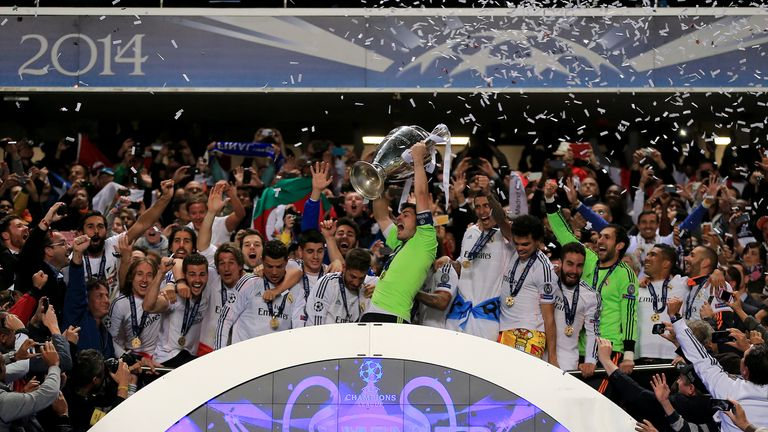 Real Madrid's Iker Casillas lifts the UEFA Champions League Trophy