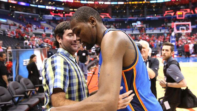 Kevin Durant is congratulated by Masters champion Bubba Watson