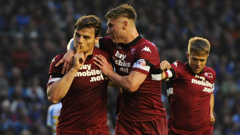 Chris Martin (L): Celebrates after scoring in the first-leg win over Brighton