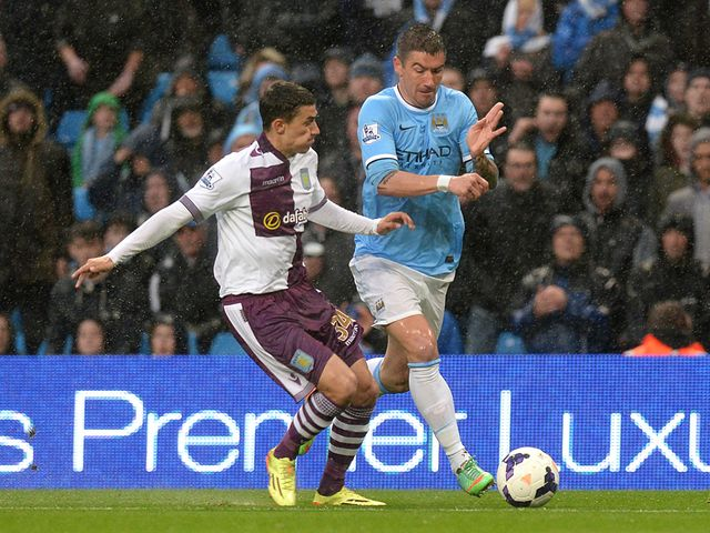Matthew Lowton and Aleksandar Kolarov tussle for possession