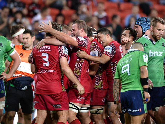 The Reds celebrate against the Highlanders