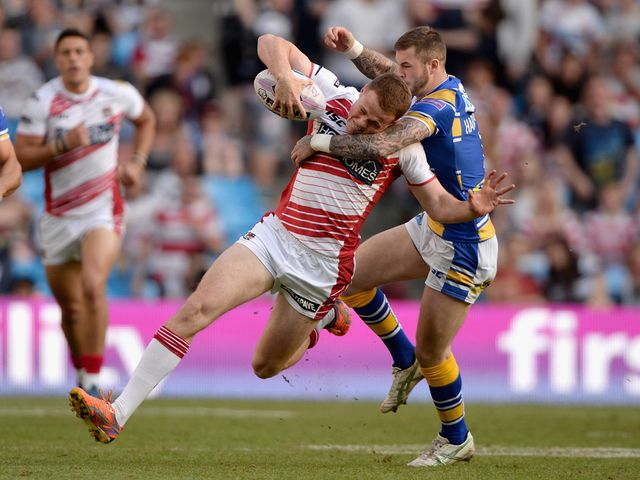 Joe Burgess tries to get away from Zak Hardaker