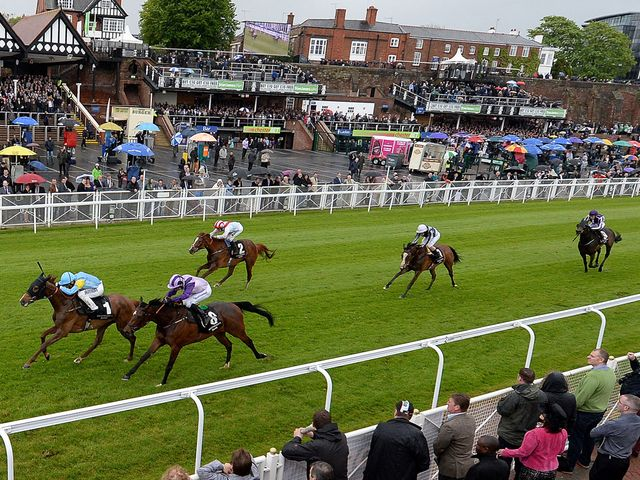 Anipa (left) ridden by Andrea Atzeni wins The Weatherbys Private Banking Cheshire Oaks.