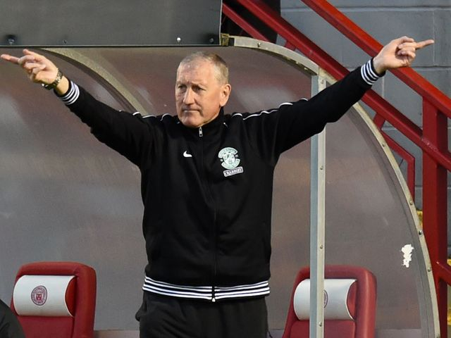 Hibernian manager Terry Butcher urges his side on
