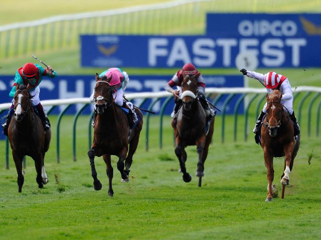 Night Of Thunder (right) comes to catch Kingman (pink cap) to win the QIPCO 2000 Guineas.