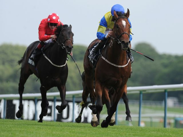 Aeolus ridden by Richard Hughes (right) wins the New Timeform Flags Sandy Lane Stakes