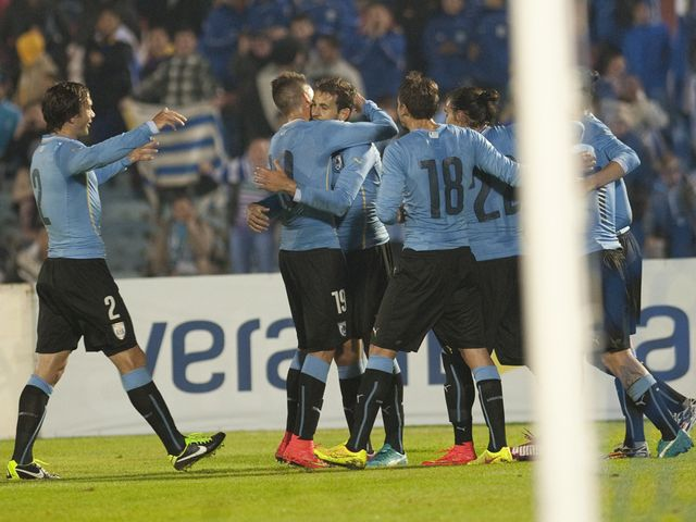 Uruguay's playes celebrate against Northern Ireland