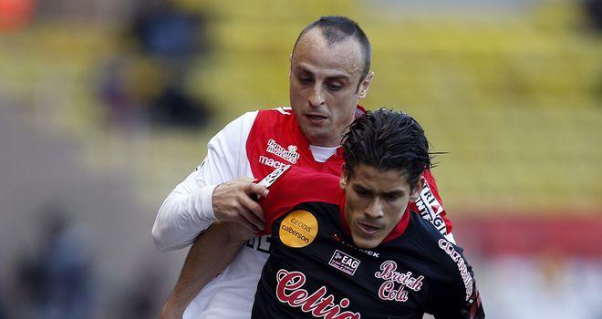 Monaco's Dimitar Berbatov challenges Dorian Leveque
