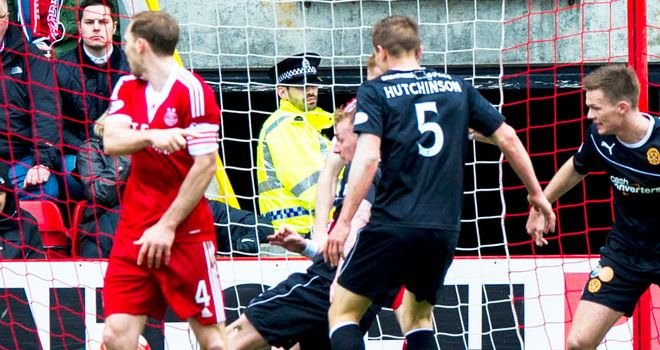 Craig Reid scrambles in the late winner for Motherwell at Aberdeen