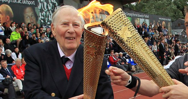 Sir Roger Bannister lights the Olympic flame back in 2012 at the track where he made athetics history
