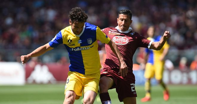 Marco Parolo is tackled by Giuseppe Vives