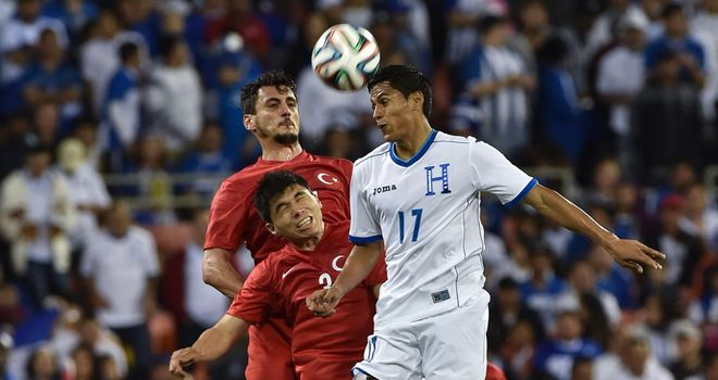 Andy Najar: Goes up for a header against Turkey