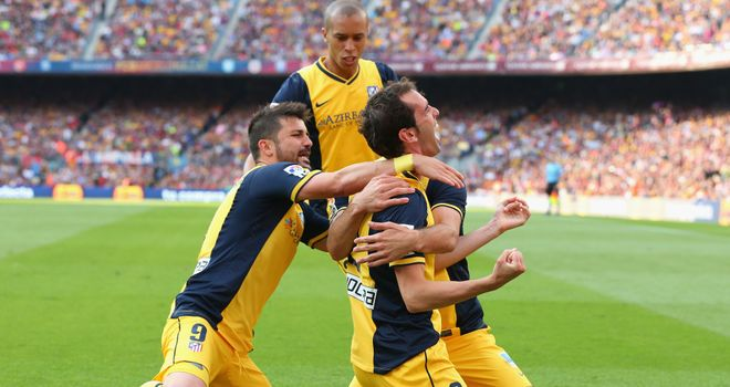 Diego Godin: Celebrates netting the crucial equaliser for Atletico Madrid