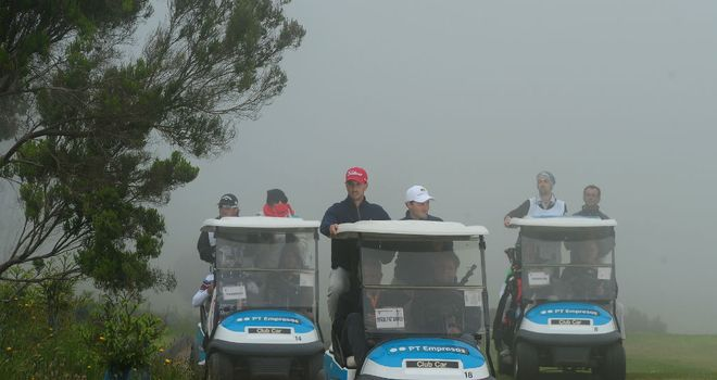 Competitors make their way back to the clubhouse after more fog in Madeira