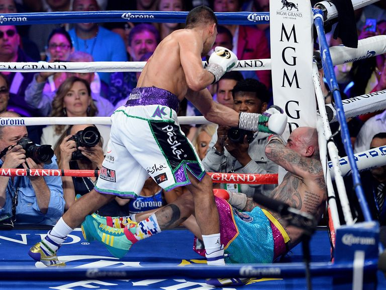 Amir Khan drops Luis Collazo to the canvas
