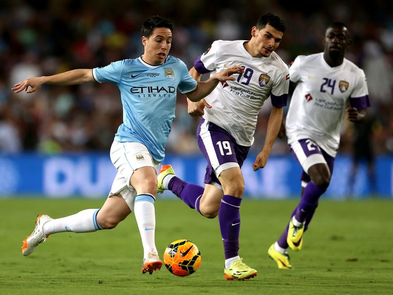 Samir Nasri tries to shake off two defenders