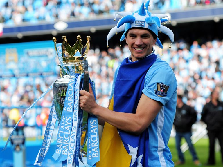Edin Dzeko poses with the Premier League trophy in 2012