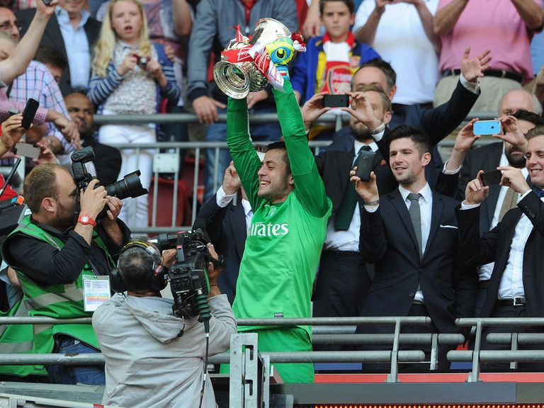 Lukasz Fabianski lifts the FA Cup. He says he will 'probably' now leave Arsenal