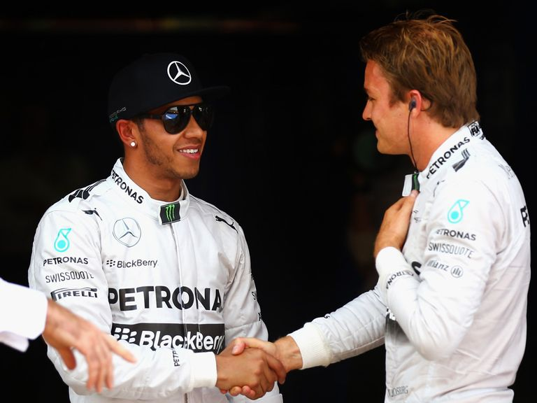 Lewis Hamilton (l) is congratulated by team-mate Nico Rosberg