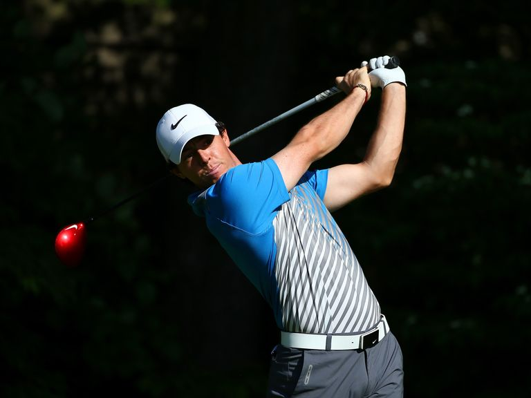 Rory McIlroy hits a tee shot on the 13th hole.