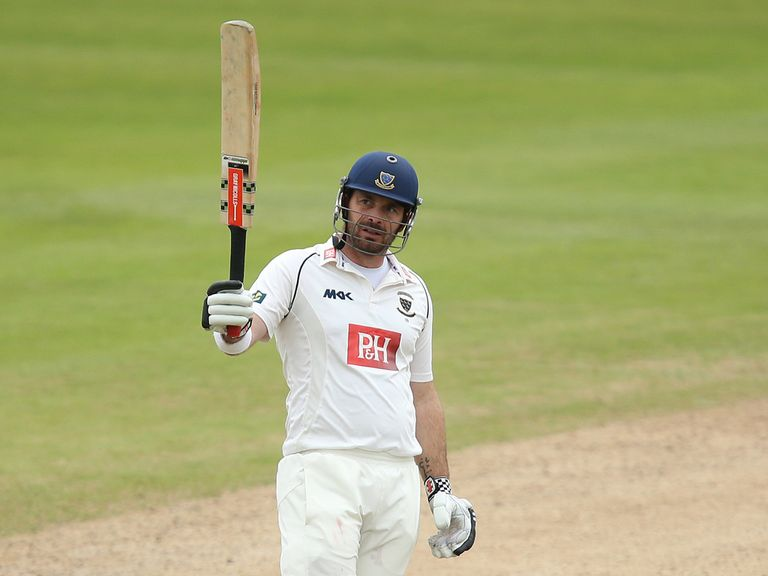 Michael Yardy of Sussex acknowledges the applause on the way to making a century on Sunday
