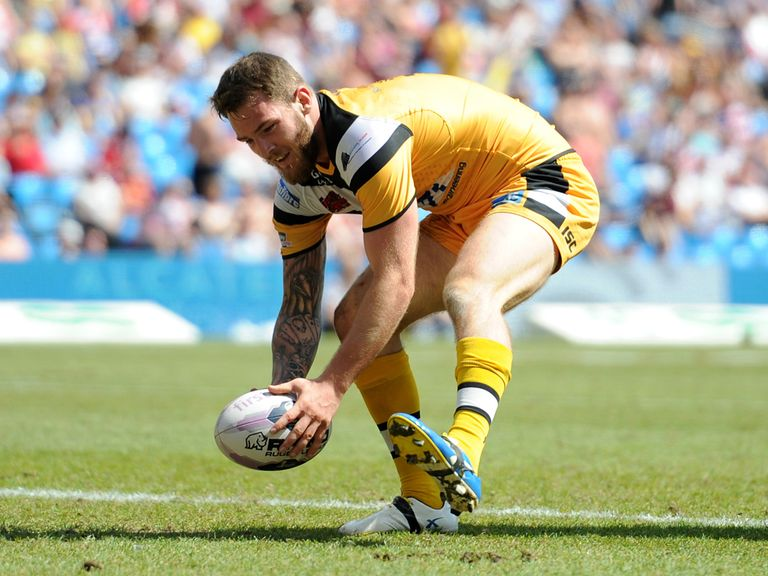 Castleford Tigers' Daryl Clark touches down for a try