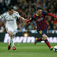 MADRID, SPAIN - MARCH 23: Lionel Messi of Barcelona goes past Angel Di Maria of Real Madrid during the La Liga match between Real Madrid CF and FC Barcelon