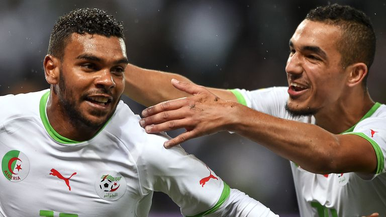 Nabil Bentaleb and El Arabi Soudani: Celebrate after scoring against Romania