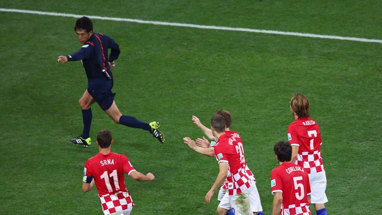 Croatia protest as referee Yuichi Nishimura points to the spot