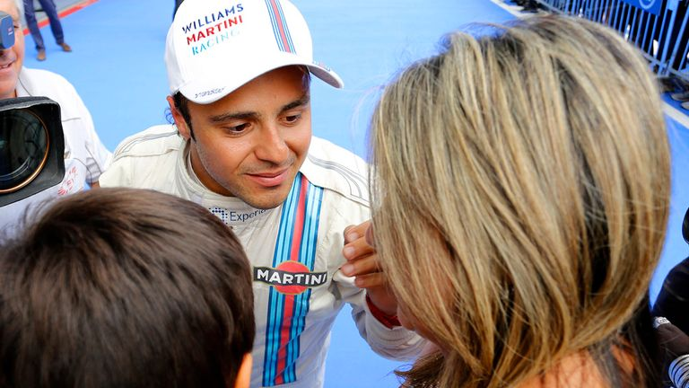 Felipe Massa celebrates with his wife and child
