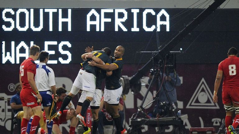 Romain Poite (in white) watches on as the Springboks celebrate a try
