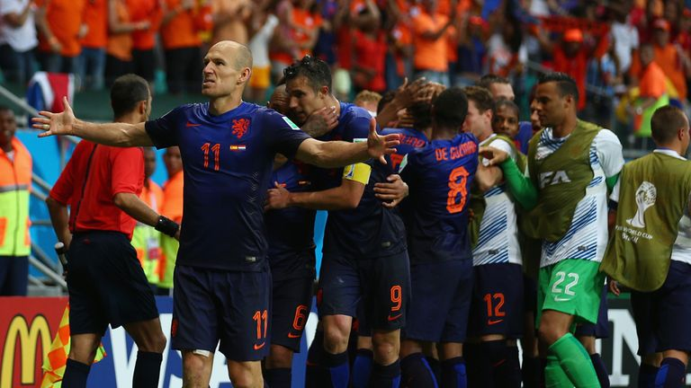 Arjen Robben scored two of Holland's five goals against holder Spain