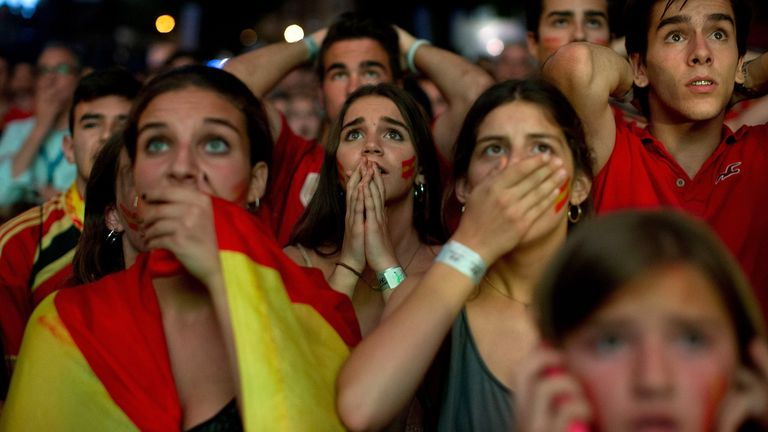 Spain fans: Shock early exit for their side