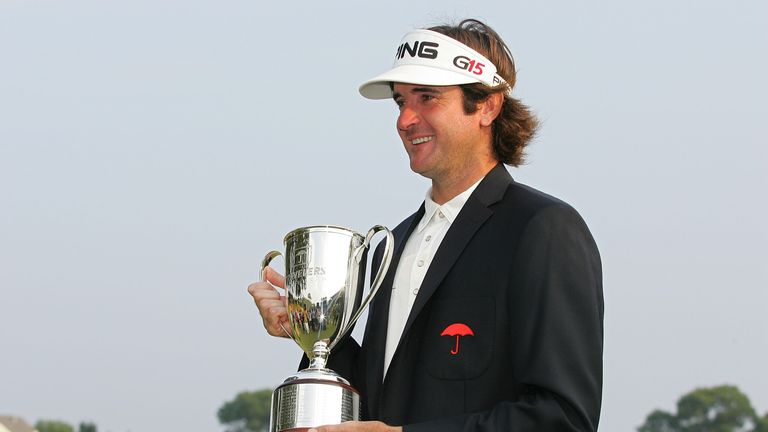 Bubba Watson holds the trophy after his victory in 2010