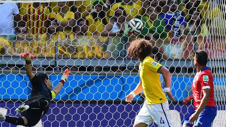 David Luiz and Gonzalo Jara look on as the ball heads for the back of the Chile net